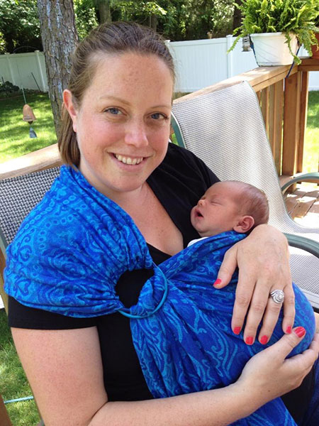 Founder Kaitlin McGreyes holding 2 day old son